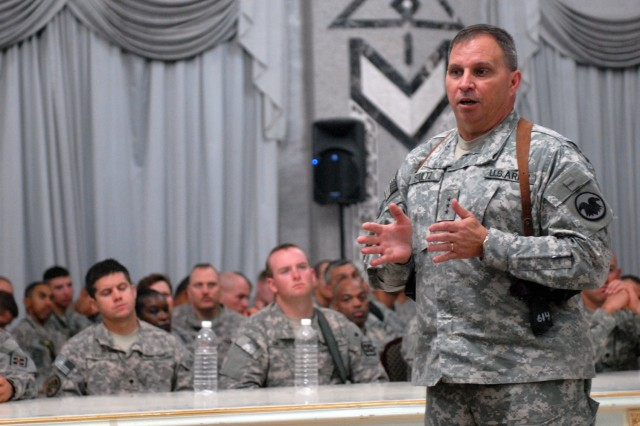 "BAGHDAD - ""It's no longer your one weekend a month, two weeks in the summer Reserve force,"" said Lt. Gen. Jack Stultz, at al-Faw Palace, here, July 26. ""We're working hard for ya; we just need you to stick with it."" Stultz addressed Army Reserve Soldiers from Multi-National Division - Baghdad and other units all over Baghdad. The chief of the Army Reserve answered questions on issues such as retirement, healthcare, deployments, training, employer relationships with the Army Reserve, retention and recruiting as well as the future structure of the Army Reserve."