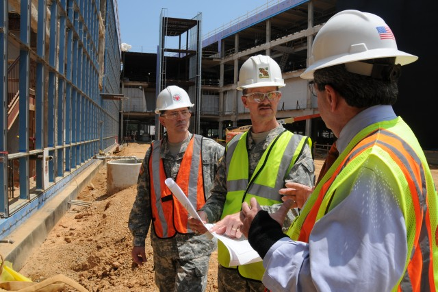 Col. Charles Callahan (center), commander of DeWitt Army Community Hospital and Health Care Network, explains the plans for the new Fort Belvoir Community Hospital during a tour. When complete, the 1.3-million-square-foot joint military hospital will have 120 single-patient rooms.