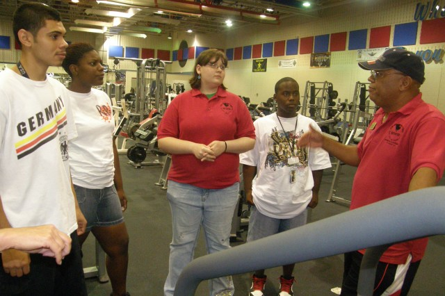 Jose Cruz Laporte (right), director of Wheelock Bayou Fitness Center, talks with several members of Fort Polk's Child Youth and School Services new Hired program. He explains some of the duties they will have if they intern at the fitness center.