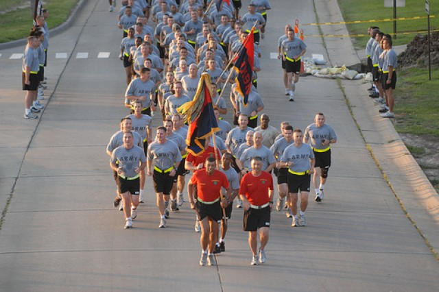 """Maj. Gen. Vince Brooks and Command Sgt. Maj. Jim Champagne lead the 1st Infantry Division around Custer Hill during the 3.6 mile """"Victory Run."""""""