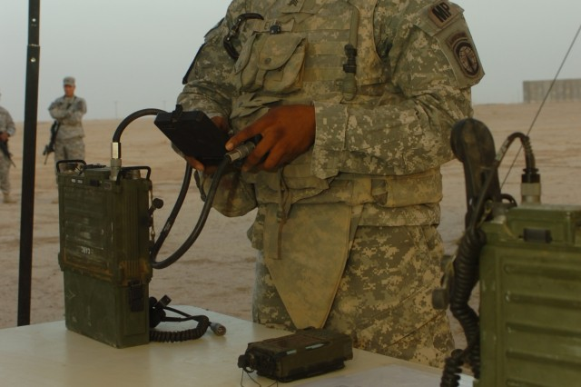 "Sgt. Sydney Evans, 139th Military Police Company, 607th MP Battalion, prepares a radio for use as part of a technical knowledge trial during the ""Joint Best Warrior Competition – Multi-National Division – North"" held at Contingency Operating Base Speicher, near Tikrit, Iraq, July 28. Evans is one of 19 Soldiers and one Sailor competing in the four-day competition designed to challenge competitors with  physical events, decision-making scenarios and technical knowledge to find the ""top warrior"" currently deployed to northern Iraq in support of Operation Iraqi Freedom. (U.S. Army photo by Pfc. Jesus J. Aranda, Task Force Lightning Public Affairs)"