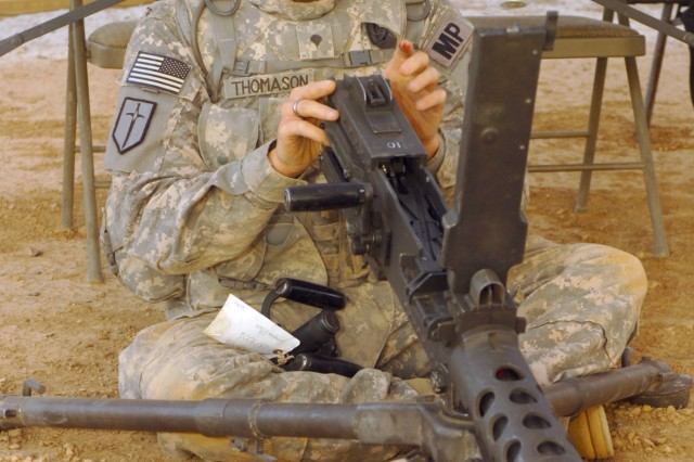 "Spc. Tommy Thomason, 204th Military Police Company, 607th MP Battalion, assembles an M2 .50 caliber machine gun during a timed trial, as part of the ""Joint Best Warrior Competition – Multi-National Division – North"" held at Contingency Operating Base Speicher, near Tikrit, Iraq, July 28. Herman is one of 19 Soldiers and one Sailor competing in the four-day competition designed to challenge competitors with  physical events, decision-making scenarios and technical knowledge to find the ""top warrior"" currently deployed to northern Iraq in support of Operation Iraqi Freedom. (U.S. Army photo by Pfc. Jesus J. Aranda, Task Force Lightning Public Affairs)"