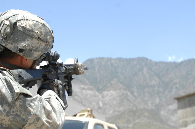 KONAR PROVINCE, Afghanistan - U.S. Army Capt. Adam MacAllister, commander, Company C, 3rd Squadron, 61st Cavalry Regiment, 4th Brigade combat Team, 4th Infantry Division, looks through his scope providing security in Konar province, Afghanistan, July 15. (Photo by U.S. Army Spc. Evan D. Marcy, 55th Signal Company)