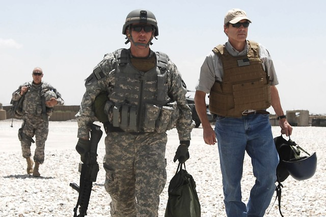Texas Gov. Rick Perry is escorted off the flight line on July 21st at Ghazni, Afghanistan by Lt. Col. Thomas J. Kleis, commander of the 636th Military Intelligence Battalion, 71st Battlefield Surveillance Brigade headquartered at Camp Mabry in Austin, Texas. Perry led a delegation with four other governors to visit service members in the country. (Photo by U.S. Army Master Sgt. Ken Walker, 636th Military Intelligence Public Affairs)
