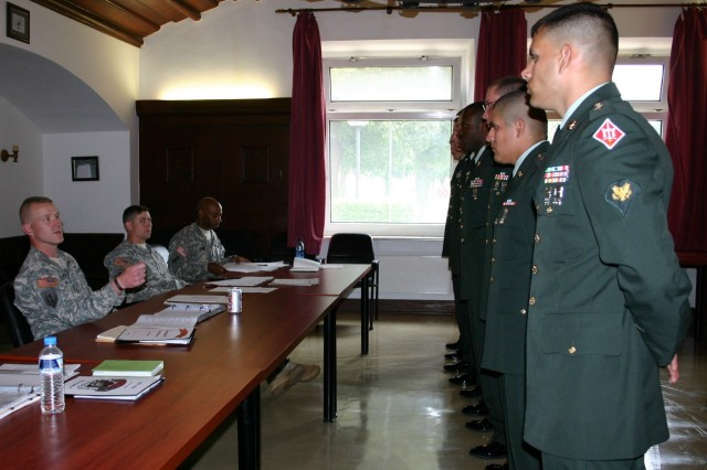 Command Sgt. Maj. Bradley Houston, 15th Engineer Battalion, left, gives instructions to Soldiers and NCOs just prior to their board presentation, the final event of the battalion's Soldier and NCO of the Year competition.