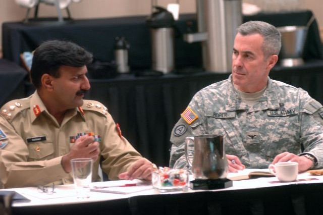 ATLANTA, Ga., (July 22, 2009) - Col. Daniel S. Roper, Director, U.S. Army and Marine Corps Counterinsurgency Center, discusses lessons learned in counterinsurgency with Brigadier Farhat Abbas Sani, Pakistan Mitary Air Defense brigade commander, during Third Army/U.S. Army Central's Counterinsurgency Information Exchange in Atlanta, July 22. During the exchange, leaders from the Pakistan military and U.S. Army discussed counterinsurgency efforts in both countries.