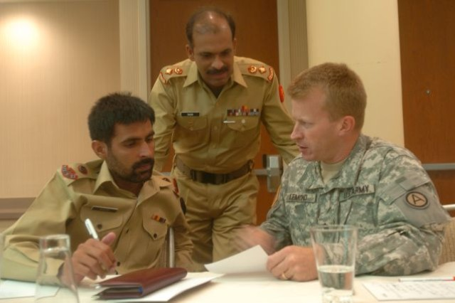 ATLANTA, Ga., (July 22, 2009) - Lt. Col. Chad Lemond, Third Army/U.S. Army Central G-5, discusses counterinsurgency methods with (pictured from left) Major Naeem Ahmed, Pakistan Army infantry company commander, and Lt. Col. Saqid Mahmood Malik, Pakistan military infantry battalion commander, during Third Army/U.S. Army Central's Counterinsurgency Information Exchange in Atlanta, Ga., July 22. The week-long seminar provided a venue to discuss lessons learned as well as foster relations between the two countries.
