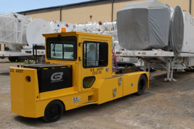 The electric fifth wheel tug transports a Multiple Threat Emitter System.