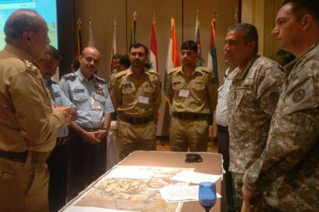 ATLANTA, Ga. (July 21, 2009) - (Pictured from left) Brig. Gen. Muhammad Amir Khan, Pakistan Army Pilot, speaks with Col. Ai-Al Humaidi, Yemen Air Force pilot, Lt. Col. Mohamed Mohamed Alzahree, Yemen Air Force pilot, Lt. Col. Zahid Halim Qureshi, Pakistan Army pilot, Maj. Kamran Hashmi, Pakistan Army maintenance engineer, Chief Warrant Officer Jaime Escobar, Third Army/U.S. Army Central panther Team, and Sgt. 1st Class William O'Brien, Third Army/USARCENT Panther Team discuss a mock exercise on aviation tactics at the International Aviation Symposium in Atlanta, Ga., July 21. The five-day symposium provided a venue for participants to learn from each country's aviation programs while building relationships amongst each other.