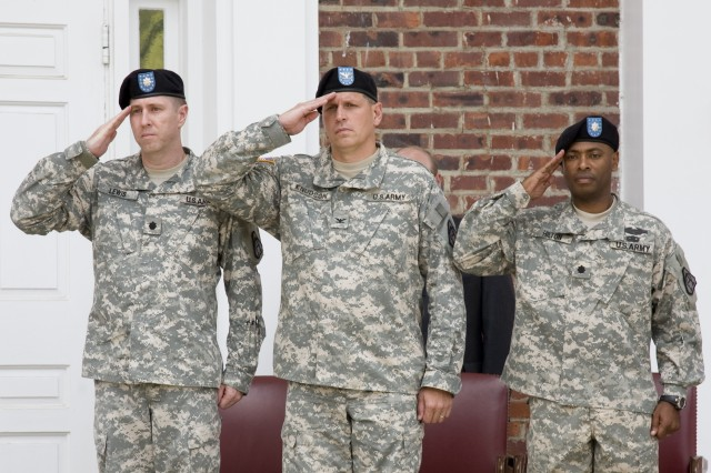 (From left) Outgoing Product Manager for Mortars Lt. Col. John Lewis, Project Manager for Combat Ammunition Systems Col. Ole Knudson and incoming PM Mortars Lt. Col. Norman Hilton salute during the PM Mortars change of management ceremony here July 10.