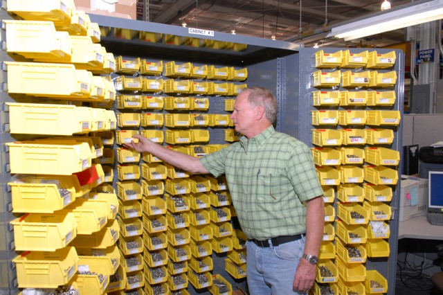 Keith Wheeler, electronics mechanic leader, pulls parts from one the depot's 7,000 Industrial Product-Support Vendor (IPV) storage bins.  Wheeler works in the Intelligence, Surveillance and Reconnaissance Directorate's Surveillance Systems