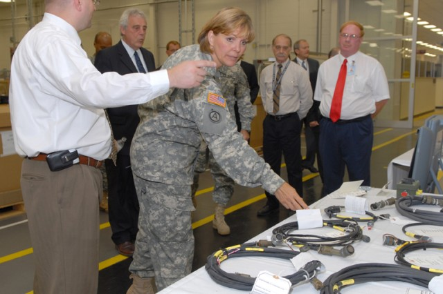 Brig. Gen. Patricia E. McQuistion, commanding general, Defense Supply Center Columbus, tours depot work areas July 2 before  participating in the Industrial Product Support Vendor Program ribbon-cutting ceremony.