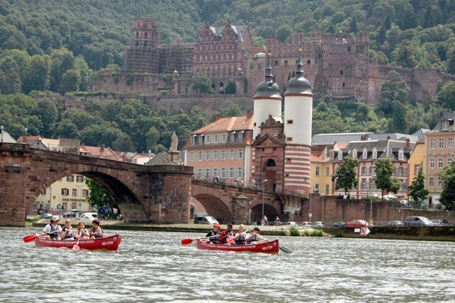 Camp A.R.M.Y. Challenge canoers glide past the Heidelberg, Germany, bridge and castle as part of a weeklong city adventure in 2007. The camp was held for children of deployed Soldiers.