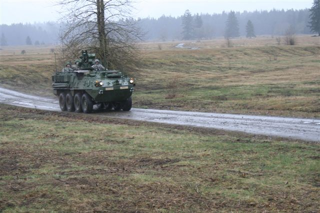 A Stryker vehicle travels through the location of the Warfighter Information Network-Tactical (WIN-T) Limited Users Test held in March at Fort Lewis, Wash