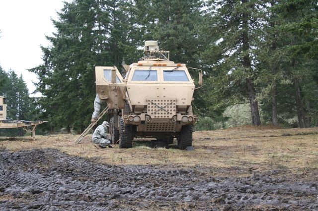 Soldiers prepare a Tactical Communications Node for use at the Warfighter Information Network-Tactical Limited Users Test held in March at Fort Lewis, Wash.