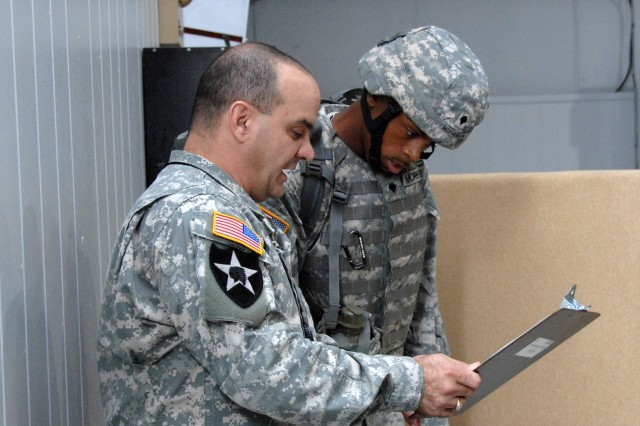 AMC Soldier of the Year winner, Spc. Darwynn McPherson, 688th Transportation Detachement, SDDC, Fort Eustis, Va., receives his warrior task instruction during the competition.