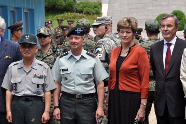 U.S. Forces Korea Commander Gen. Walter L. Sharp and U.S. Ambassador to South Korea Kathleen Stephens pose for pictures with participants from the commemoration ceremony at the Korean Military Demarcation Line July 27.