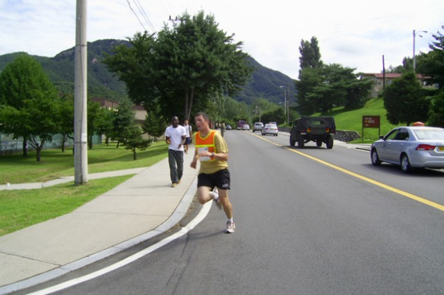 Pete Bauleke crosses the finish line bringing home the trophy for 1 with an overall time of 1:36:14 during the 2009 Warrior Country Team Triathlon July 25.