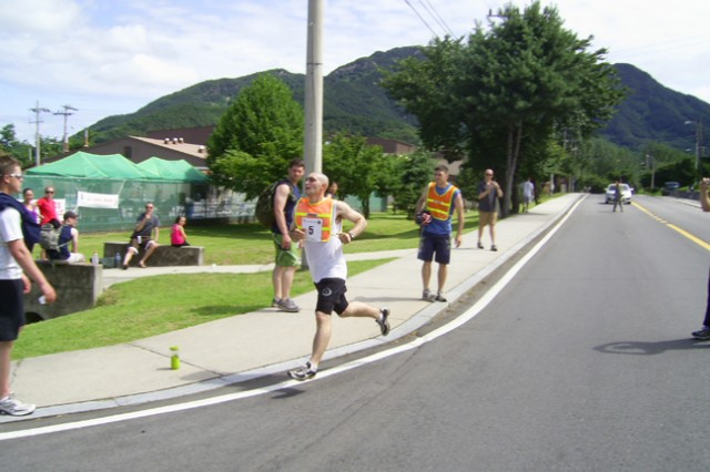 James DeBerm crosses the finish line bring home the trophy for 2 with an overall time of 1:39:34 during the 2009 Warrior Country Triathlon July 25.