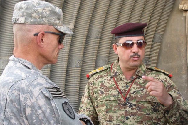 Maj. Gen. Robert Caslen, commander of the 25th Infantry Division, and Iraqi Army Lt. Col. Khalid Hajji Mohammad, deputy commander of the Iraqi Army's 16th Brigade, discuss the construction of a joint training center currently being built by U.S. Soldiers at Matar al-Saddiq July 17.