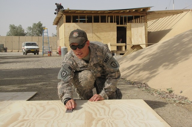 Staff Sgt. Jason Nash, Special Troops Battalion, 3rd Infantry Brigade Combat Team, 25th Infantry Division, prepares to cut a half-wall that will be used to build a Military Operations and Urban Terrain (MOUT) training house for both CF and the IA July 15.    As part of the CF effort to help rebuild the IA's capabilities, joint training events will routinely take place to ensure that new Iraqi soldiers are well-equipped to handle the full spectrum of Iraqi security.