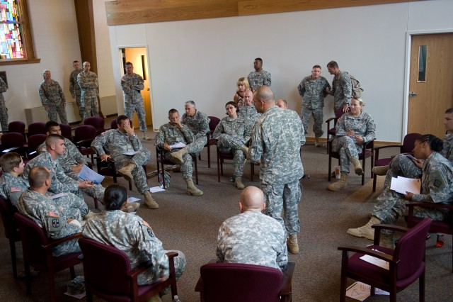 An Army Chaplain leads Applied Suicide Skills Training to a group of Soldiers while the Chief of Staff of the Army Gen. George W. Casey Jr. observes at the Spiritual Fitness Center on Fort Hood, Texas, July 28, 2009.