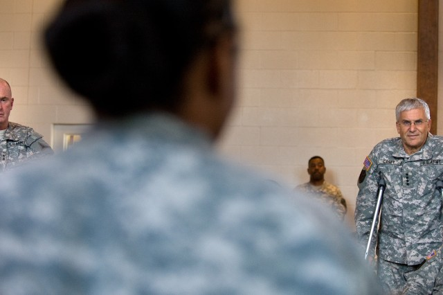 A Soldier participating in Applied Suicide Skills Training (ASIST) tells the Chief of Staff of the Army Gen. George W. Casey Jr. about her thoughts of the training at Fort Hood, Texas, July 28, 2009. Casey observed the ASIST training and offered the class an update on what the Army is doing to address suicides.