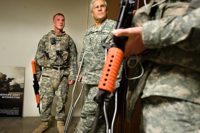 Pfc. Levisee and Pfc. Matthews talk with the Chief of Staff of the Army Gen. George W. Casey Jr. about the unique training their receiving on the Resiliency Campus at Fort Hood, Texas, on July 28, 2009. Casey is visiting Fort Hood and other Army facilities to examine what local commands are doing to help Soldiers and their families deal with the challenges being asked of them.