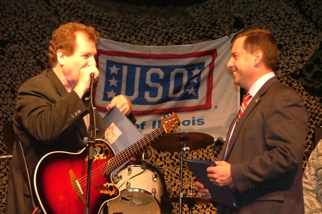 """Tony Enrietto, President, USO of Illinois, thanks Joe Cantafio and his band, the 101st Rock Division, for their constant support to the troops.  The USO sponsored the first taping of the live music show """"The Midnight Stage,"""" in Palatine, IL with special guests in the audience: hundreds of local Soldiers."""