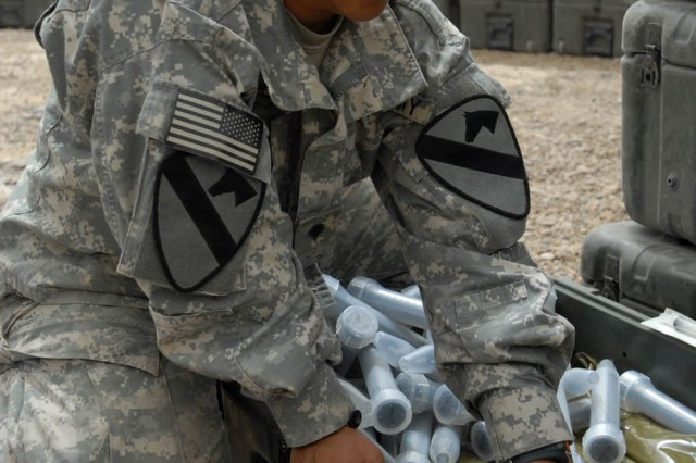 """BAGHDAD - Gatesville, Texas native, Spc. Delila Jones, medic for Company C, 115th """"Muleskinners"""" Brigade Support Battalion, 1st Brigade Combat Team, 1st Cavalry Division, packs and inventories sick call equipment, July 28, in preparation for movement to Camp Taji from Joint Security Station WarEagle."""