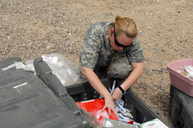 """BAGHDAD - Orange County, Calif. native, Pfc. Candice Stark, medic for Company C, 115th """"Muleskinners"""" Brigade Support Battalion, 1st Brigade Combat Team, 1st Cavalry Division, packs and inventories various medical equipment, July 28, in preparation for movement to Camp Taji."""
