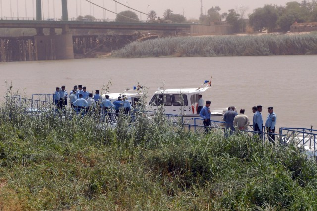 BAGHDAD - Iraqi Police gather for the graduation ceremony of the newest Iraqi Police River Patrol Dive recruits along the Tigris River July 30.