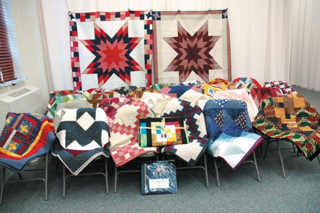 More than 30 colorful quilts created for donation to Wounded Warriors at Walter Reed Army Medical Center are displayed at the Edgewood Area Chapel during the quilt blessing hosted by Quilts For Heroes.