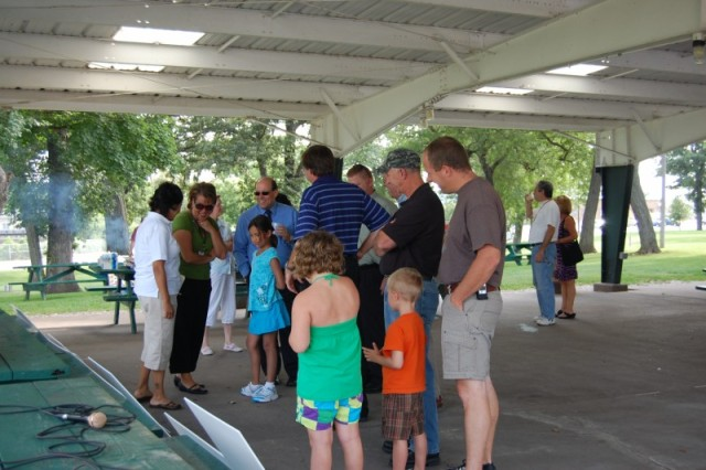 Family members observe all the safety posters at the cookout.