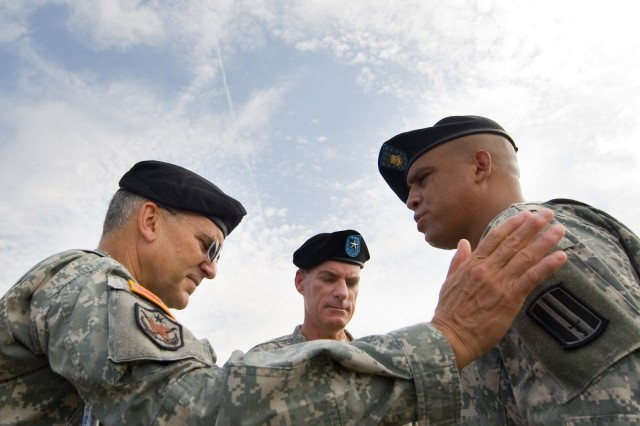 """Army Times 2009 """"Soldier of the Year"""" 1st Sgt. Peter J. Lara talks with Chief of Staff of the Army Gen. George W. Casey Jr. and Brig. Gen. Bradley May at Fort Jackson, S.C., on July 30, 2009."""