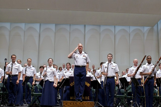 Col. Thomas H. Palmatier, Commander of The United States Army Field Band, salutes audience members at a recent performance in The Woodlands, Texas. More than 7,500 residents in the greater-Houston area came out to watch The Musical Ambassadors perform July 28.