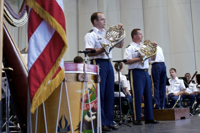 Staff Sgt. Stephen Aaron (left) performs with Sgt. 1st Class Bob Cherry at The Woodlands, Texas. Aaron, from Kingwood, Texas, was pleased to play his french horn for family members who came out to support him at The United States Army Field Band concert July 28.