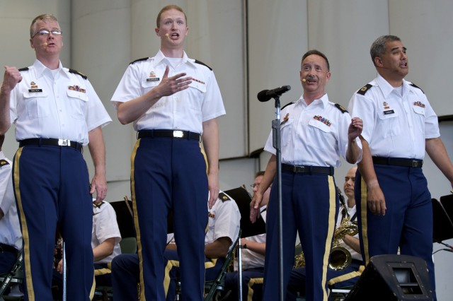The Army Field Band's popular barbershop quartet, Soundoff, peforms for thousands at The Woodlands Pavilion located on the outskirts of Houston, Texas, on July 28. Pictured (from left) are Sgt. Maj. Joel Dulyea, Staff Sgt. Brendan Curran, Sgt. Maj. Robert Barnett and Master Sgt. Bill Gabbard.