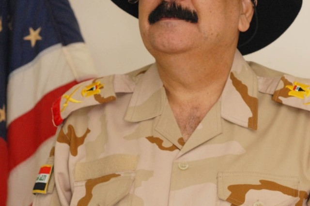 "BAGHDAD - Staff Maj. Gen. Mizher Shaher Lateef, 11th Iraqi Army Division commander, proudly wears his 1st Cavalry Div. stetson presented to him by Kenton, Ohio native Brig. Gen. John Murray, deputy commanding general for maneuver, 1st Cav. Div., Multi-National Division-Baghdad, and Sioux Falls, S.D. native, Col. Tobin Green, commander of the 1st ""Ironhorse"" Brigade Combat Team, 1st Cav. Div. at Mizher's farewell dinner at Joint Security Station War Eagle, north of Baghdad, July 30. Also presented was a set of gold spurs; both are considered the highest honor to receive from the 1st Cav. Div. Mizher started the 11th IA Div. in 2007 when the ""Ironhorse"" Brigade was last deployed in the Baghdad area. Green said when he was told that brigade was returning to Baghdad to work with the 11th IA Div. and Mizher, he was excited."