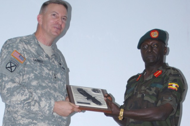 Maj. Gen. William B. Garrett III, commander of U.S. Army Africa, exchanges a gift during a July 30 visit to the Kimaka Senior Command and Staff College.