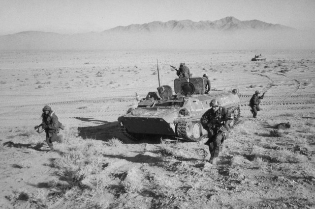 """OPFORS Ground Assault. This image shows OPFORS  ground and armor unit during exercises in the desert of the NTC, December,1983. (USAMHI RG 97S)."""""""