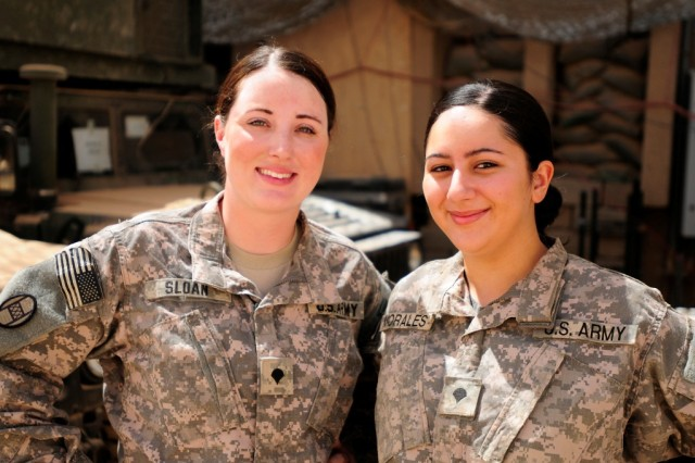BAGHDAD -- Spc. Felicia Sloan (left), of Lumberton, N.C., and Spc. Yessenia Morales, of High Point, N.C., are drivers with the personnel protection detachments that shield the 30thHeavy Brigade Combat Team's command group at Forward Operating Base Falcon.   The two military policemen mainly work with infantrymen, which is traditionally a male-only field.