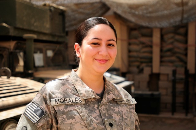 BAGHDAD -- Spc. Yessenia Morales, of High Point, N.C., is a Caiman mine resistant ambush protected vehicle driver on a team that protects the 30thHeavy Brigade Combat Team's command group at Forward Operating Base Falcon.