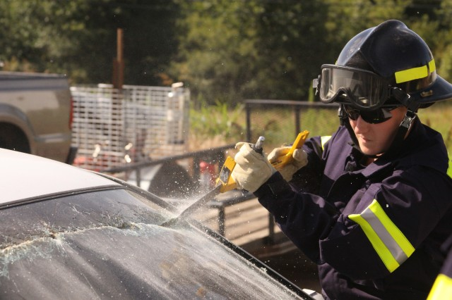 An Army Reserve Soldier from the 395th Ordinance Company, Appleton, Wis., uses a cutting tool on a windshield during a vehicle extraction training exercise held at the MCAAP firehouse. Soldiers learned how to properly use many types of equipment used in the removal of trapped persons in damaged vehicles. (Photo by Army Staff Sgt. Shane Slaughter, 319th MPAD)