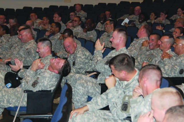 Fort Polk noncommissioned officers react to a joke given by Christian humorist Dennis Swanberg during a leadership seminar at Bayou Theater July 24.