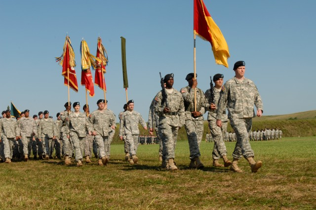 """Col. Joseph Harrington, commander of the 75th Fires Brigade, Fort Sill, Okla., marches troops during the 1st Infantry Division's Victory Week division review. Harrington's brigade wasn't the only non-Fort Riley unit represented, the 4th Maneuver Enhancement Brigade from Fort leonard Wood, Mo., and the 1st Inf. Div.'s 3rd Brigade from Fort Hood, Tex., were also in the formation."""""""