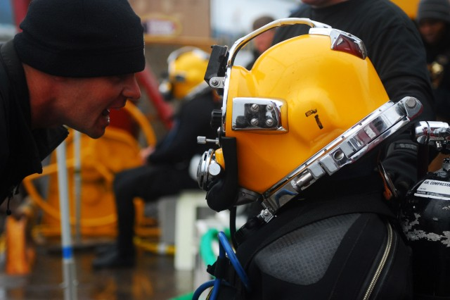 Staff Sgt. Joshua West, a diving supervisor with the 7th Diving Team, confirms that Sgt. Jake Cochran, the lead diver with the 7th Diving Team, is ready for his dive.