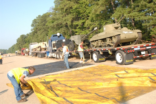 Workers unload approximately 60 tanks and artillery pieces Aug. 4 during the first phase of transfer, as the U.S. Army Ordnance Museum relocates nearly 200 pieces of its collection from Aberdeen Proving Ground, Md., to Fort Lee, Va. Photo by Mike Strasser