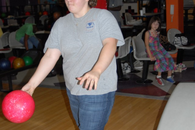 Felisha Burkes, along with other Fort Stewart youth volunteers were treated to pizza and a round of bowling at Stewart's Marne Lanes after being recognized for their work as volunteers, July 31.