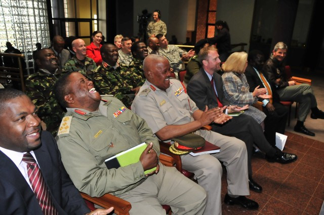 UMBUTFO, Swaziland - U.S. and Umbutfo Swaziland Defence Force (USDF) service members and U.S. Embassy leaders laugh at comments by the master of ceremonies during the opening ceremony for a medical exercise at the USDF headquarters in Manzini, Swaziland, August 3, 2009. MEDFLAG is a joint and combined military exercise led by U.S. Army Africa in support of U.S. Africa Command to improve medical disaster preparedness and humanitarian assistance management.